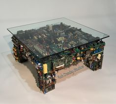 Custom Coffee Table made from recycled circuit boards from audio video components. Limited edition furniture, designed and handcrafted by artist Rob Dzedzy, is available for purchase. Contact Media Rooms Inc. www.mediaroomsinc.com. Phone: 610.719.8500.