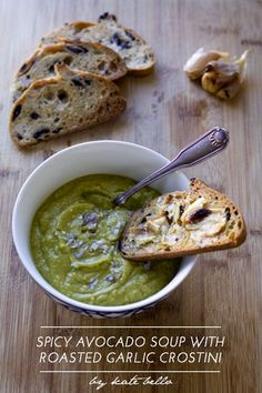 Avocado soup with roasted garlic crostini. When garlic is roasted, it gets very creamy and makes a delicious spread on bread or toast - this recipe takes it to the next level by dipping it in creamy avocado soup!