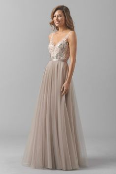 Luxuriate in the ephemeral delicacy of the Watters Blair 8355i bridesmaid dress. This striking gown is fashioned from sequined Lucca lace and bobbinet over illusion netting. The bodice features a V-neckline and V-back, framed with illusion shoulder straps. The waistline is cinched with a double-faced satin ribbon above the long A-line skirt which flows fabulously in the softest of folds.