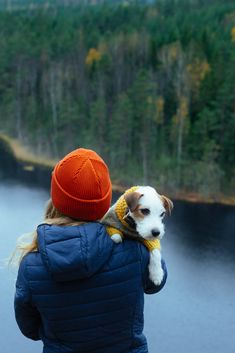 Dog and dog mom on top of the world. Hiking with dog. Dog in a sweater.