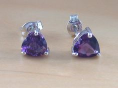 Sterling silver, love heart earrings with genuine amethyst gemstones. Each earring measures 7mm. Both earrings are stamped 925. Amethyst is the birthstone for February. These earrings will be gift wrapped in acid free tissue paper and pretty organzo gift bag. Includes amethyst gemstone descrip...