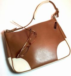 Coach Leather Kok-8148 Shoulder Bag. Get one of the hottest styles of the season! The Coach Leather Kok-8148 Shoulder Bag is a top 10 member favorite on Tradesy. Save on yours before they're sold out!
