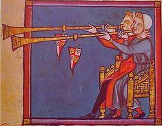 JUGLARES TOCANDO EL AÑAFIL   Aerófono formado por un tubo recto de metal que se ensancha desde la embocadura hasta la salida del aire, con lo que se consigue una adecuada resonancia. Su sonido se produce mediante la vibración de los labios del intérprete en la parte denominada boquilla, pieza con forma de pequeño embudo, como sucede en la trompeta. Pertenece al grupo de las trompas naturales, y es uno de los instrumentos de este tipo de constitución más sencilla, y no posee orificios ni…