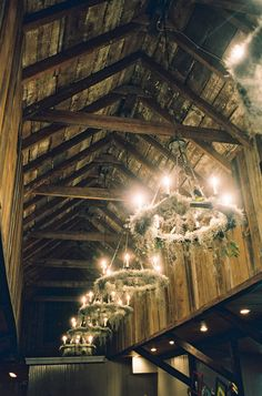 Spanish moss chandeliers in a barn wedding.