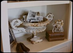 love this.  urn w/old photos.  via ~ The Old Painted Cottage Unique Goods and Curious Finds