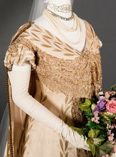 Court gown and train, by Redfern, 1907, at the FIDM Museum. Worn by Ann Bloomfield Gamble Post for her presentation to King Edward VII and Queen Alexandra.