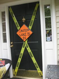 "Door decorations.  Used caution tape and a ""Caution: Jared is 2!"" sign on our back door for Jared's party"