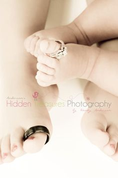 Awww zach's ring on Easton's toes & my set divided on the girls painted piggies! Love it!! This is a great picture idea - Newborn Brother and Big Sister