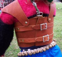 leather kid harness.  buckles in the back with a D-ring for a safety line.  Cat da Toy Lady, Etsy
