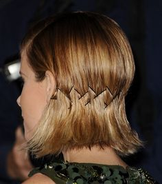 Make a cool statement with an inexpensive item. Bobby pin the nape in a chevron pattern letting the bobby pins be noticed.