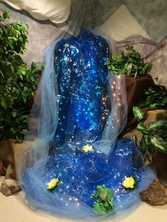 waterfall in corner, cardboard boxes draped with burlap, cellophane and blue tulle with lights. thanks Rachel Overby, Kim Sedivy and Sarah