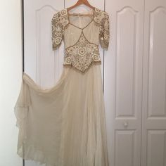 Beautiful Beaded Cream  Dress Beautiful Beaded Cream Dress!! Runs small even though is a Large I will said its a Medium. Dresses Maxi