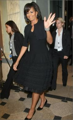 This dress looks great on Michelle. It suits her much better than the sleeveless dresses she so often wears.
