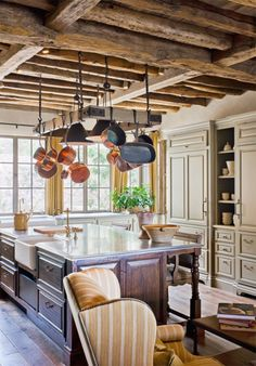 Oz Architects, Rustic Kitchen.... love the ceiling and outer counter with open shelf and fridge....treatment and baseboard