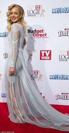 Sheer daring: Carrie'sPaolo Sebastian gown showed off her slender legs and the powder blu...