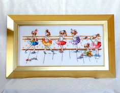 Budding Ballerinas is an enchanting framed cross stitch embroidery featuring a row of pretty little girls practising for their ballet class.    Six delightful little girls practice their steps, ready for their class. Each girl is dressed in a different colour skirt to create a wonderful and lively scene. Perfect for a girl's bedroom or nursery wall. Completely stitched by hand in Ireland.