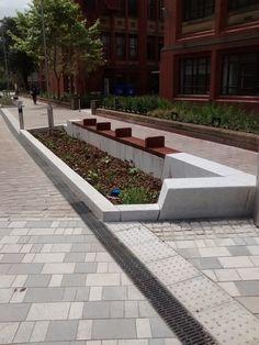 Newcastle University, bespoke granite seating / rain garden. Marshalls Better Spaces