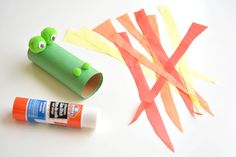 This fire breathing, toilet paper roll dragon is SO MUCH FUN! Blow into the end…