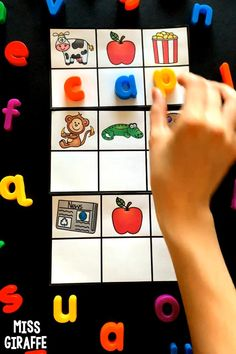 Short vowel word families are so much more fun with these activities and games for kindergarten or first grade! Kids love looking at the beginning sound for the pictures to figure out each letter and reveal the mystery cvc! She also gives a list for each set that you can use for teaching. These are just some of the ap centers! Lots of great visuals in these printables! You could even play these in preschool with support! Short I Words, Vowel Activities, Cvc Word Families, Sounding Out Words, Kindergarten Activities, Preschool, Alphabet Coloring Pages, Tracing Letters, Beginning Sounds
