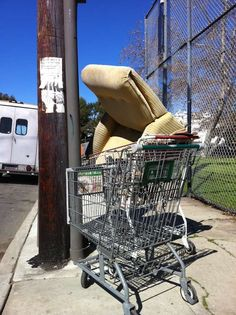 Street chair in an abandoned shopping cart next to another abandoned shopping cart. Perfect.
