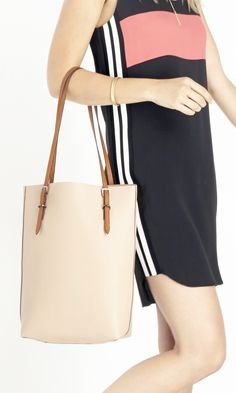 Neutral tote bag with chic thin straps... I enjoy bags that are also big enough to carry my laptop LOL