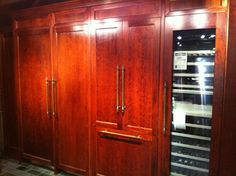 image subzero integrated fridge cabinet - *** Not this exactly, but think instead of armoire, of fridge being part of wall of cabinets.  remember the picture where the doors open fully reveal to the appliance garage (and ingredients, where we want dishes)