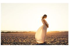 sun rays beach dress soft colors lifestyle maternity session photography