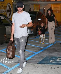 One for the men....Scott Disick with the Louis Vuitton Damier Ebene Icare