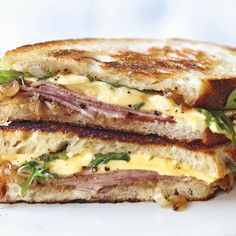 Grilled Ham and Gouda Sandwiches with Frisée and Caramelized Onions recipe | Epicurious.com