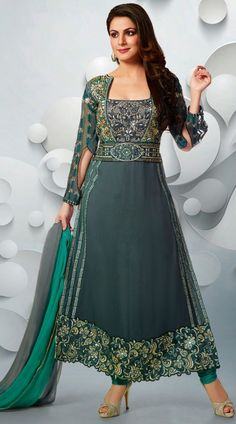 Get the designer look for yourself as the suit is dress material. Shraddha Arya, who bought a big smile on our faces with her serial Pakhi – Tumhari Paakhi have modelled for this classy grey faux georgette designer salwar kameez which is finished with the fine work of butta, lace, resham and stone work. This suit comes with matching bottom and dupatta.This Salwar Kameez can be stitched in the maximum bust size of 42 inches.