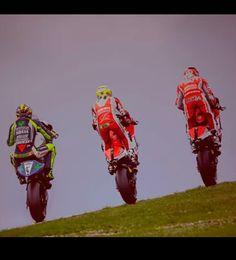 Triple wheelie! Valentino Rossi, Michael Pirro and Andrea Dovizioso