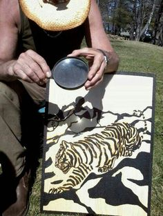 This Artist Found A Whole New Way To Harness The Power Of The Sun - Artist creates art power sunlight magnifying glass
