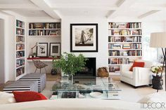 Bookcase Organizing Ideas - Elle Alternate colors, sizes, and orientation to add visual interest. Break up a colorful display of books with black-and-white artworks- home by Rebecca Ascher and Joshua Davis