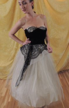 Stunning white lace and tulle 1950s prom dress with black velvet and lace peplum.  No other like it.