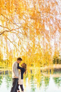Engagement picture under a yellow tree, pretty!