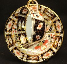 Royal Crown Derby Imari. I feel very lucky, because I have exactly this pattern, all the set, tea pot, tea, chocolate(?)  coffee cups  saucers, milk pot, a large bowl and two large plates from my britsh great-grand aunt. I am so glad to have them! Agnès B. http://www.pinterest.com/pin/141511613264928674/