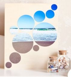 diy wall art - cut circles of different sizes from a favorite photo...