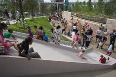 Huge 4-people-wide slide in 'The Gorge' play area of Cumberland Park in Nashville, TN - photo from Landezine;  The downtown riverside park also features other unique play areas and water features.