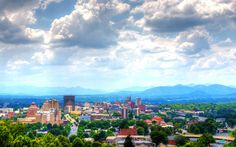 View of beautiful downtown Asheville, NC | by Sean Pavane/Getty Images