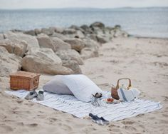 Spending a romantic afternoon at the beach... picnic and wine!! Kissing by the shoreline as the water rushes over our feet.. to me it sounds like heaven.