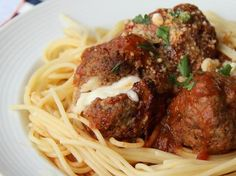 Slow-Cooker Cheese Stuffed Meatballs.  [Blogger Corey Valley of Family Fresh Meals dishes up a slow cooked meatball meal that's bound to please even the pickiest of eaters.]