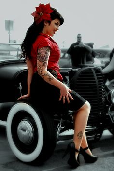 oh, how I love tats and the 50's Rock-a-Billy look... Gorgeous. (Although, i have no tattoos and am a granny.. he he he)