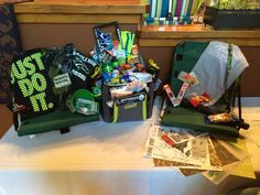 Auction basket for girls lacrosse theme sports. Stadium seats blanket and cooler used to fill full of items from socks, shirts, energy bars, to school colors nail polish and camo items too