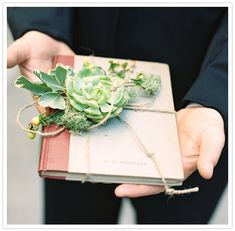 Succulent ring bearer book...such a unique idea! From http://100layercake.com/blog/2013/01/08/new-jersey-botanical-wedding-caitlin-jarrod/  Photo Credit: http://charlottejenkslewis.com/