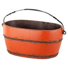 Weathered wood bucket in orange.  Product: BucketConstruction Material: WoodColor: OrangeDimensions: 7.5 H x 15.5 W x 10 D