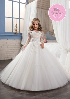 This Boston flower girl dress will charm your heart with its floral and beaded lace appliqués, illusion neckline, and textured knit lace over a fitted bodice with long sleeves. A 3-D flowers design is