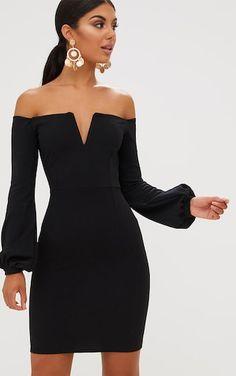 Robe moulante bardot noire manches bouffantesOn n'a jamais trop de petites robes noires! Cette p...