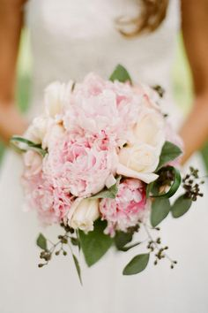 Peony and Rose Bouquet - Sweet As Spring Wedding Flowers - Southernliving. This pink peony and cream rose bouquet is lush and romantic—perfect for spring brides! SouthernWeddings.com: Tennessee Wedding Photo: Nathan Westerfield