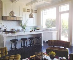 french country, white cabinets & counters, black wrought iron accents