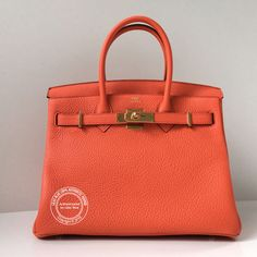 30cm Orange Poppy Birkin in Taurillon Clemence Leather with Gold Hardware. Gorgeous bright Hermes orange, new this season.For more info: whatsapp +44 7887 409934 or https://lilacblue.com/product/30cm-poppy-birkin-tc-gold/ #hermes #hermeslondon #b30 #orangepoppy #authentichermes #birkin30 #lilacbluelondon